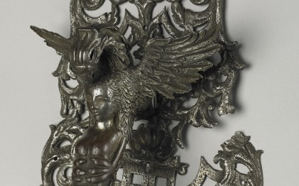 Door knocker with talons clasping female figure
